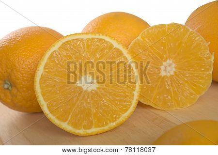 Half cross section of half peeled orange