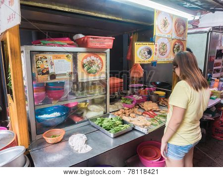 People Buying Food In Chinatown Street , Malaysia.