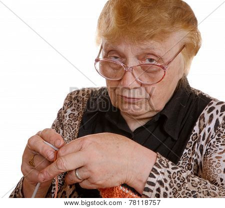 The Old Woman With Knitting In Hands