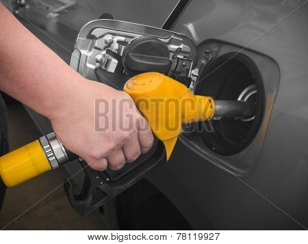 Pumping Gas At Gas Pump.
