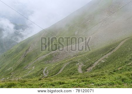 Winding Hiking Route On Green Slope