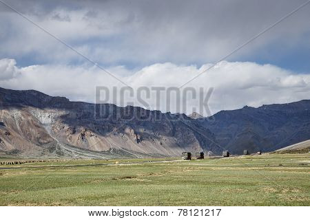Trucks Convoy In Mountains