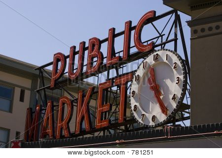 Public market sign with clock
