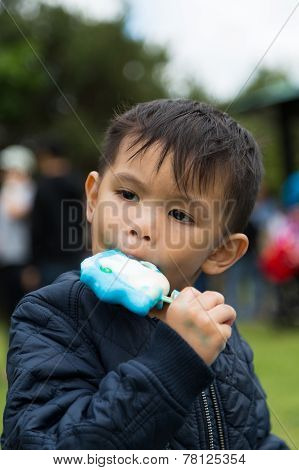 Child Eating A Lollypop