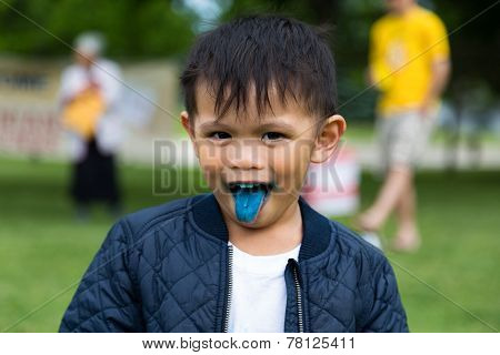 Child Sticking His Tongue Out