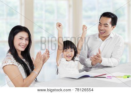 Joyful Family Finishing Schoolwork Together