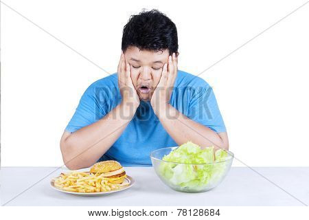 Overweight Person With Two Kinds Of Food
