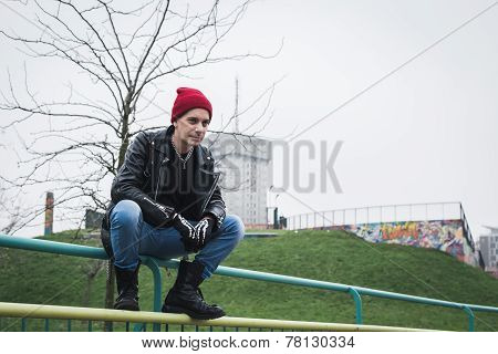 Punk Guy Posing In A City Park