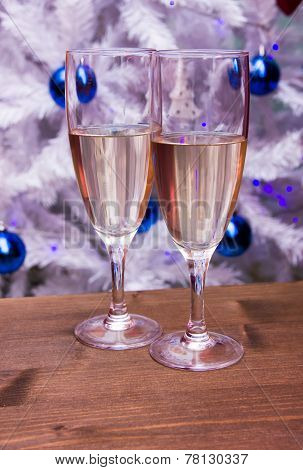 Sparkling wine in front of Christmas tree