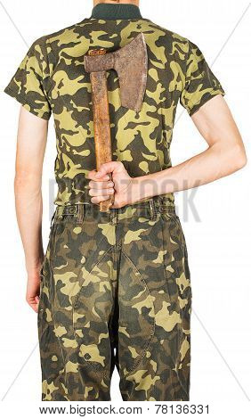 Soldier In Uniform With An Ax Behind His Back