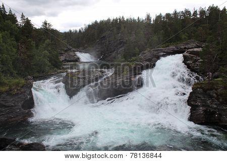 Waterfalls in the Norwegian forest.