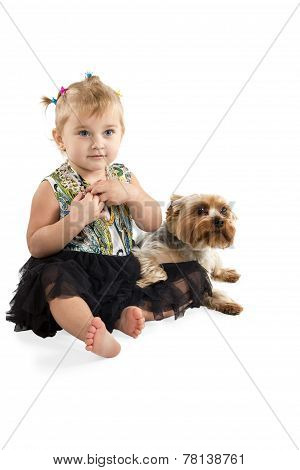 Little Girl With A Dog Sitting On The Floor