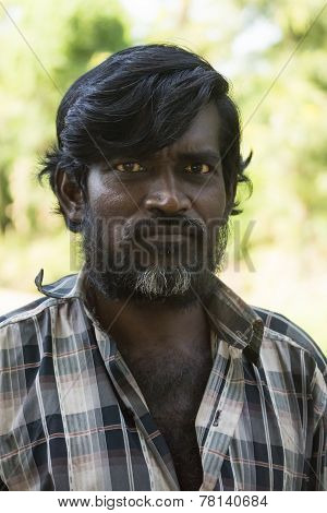 Stern-looking Tamil Man.