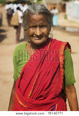 Old Tamil Woman With Red Sari.
