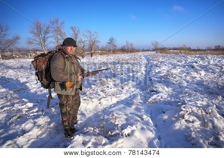 Hunter On Field Waiting Victim. Winter Hunting. Hunter Fully Prepared.