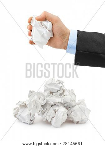 Hand and crumpled paper isolated on white background