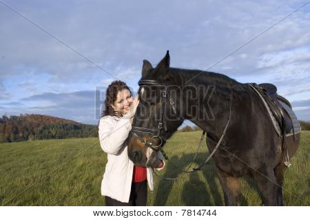 Equestrienne  Strokes A Horse.