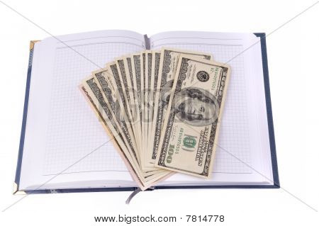 Opened Notebook With Dollars Banknotes