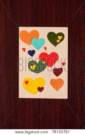 paper hearts on sheet and a wooden background