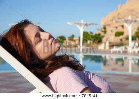 Girl Against Resort Swimming Pool