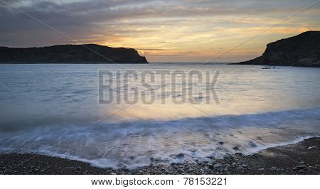 Stunning Vibrant Sunrise Landscape Over Lulworth Cove Jurassic Coast England