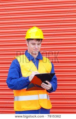 Self-assured Male Engineer Writing His Report