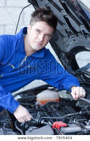 Smiling Man Repairing A Car
