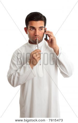 Worried Ethnic Man On Phone