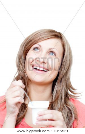 Cheerful Woman Eating A Yogurt