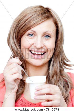 Beautiful Woman Eating A Yogurt