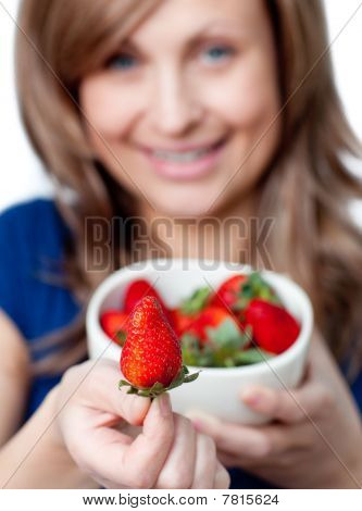 Cute Woman Eating Strawberries