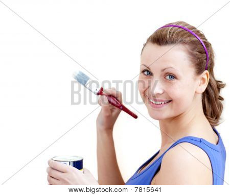 Confident Woman Using A Paintbrush