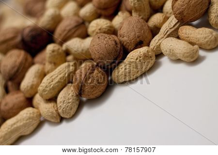 Heap Of Peanuts And Walnuts
