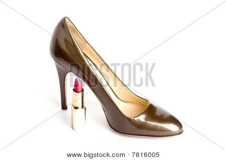 Beige-golden female new varnished shoes on high heel-stiletto and lipstick