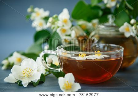 Jasmine Tea In A Teapot With A Branch Of Jasmine