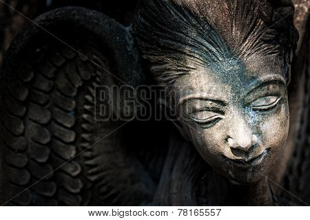 A Resting Angel Statue in low light