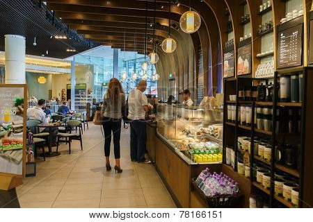 DUBAI - OCTOBER 15: Starbucks Cafe interior in the Dubai Mall on October 15, 2014 in Dubai, UAE. Starbucks is the largest coffeehouse company in the world, with more then 23000 stores