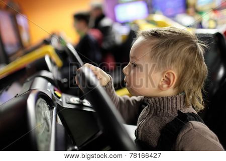 Kid Playing With Car Simulator