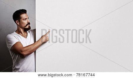 Brutal Hipster Guy With Blank Poster