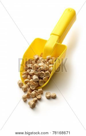 Wooden Pellets On Plastic Shovel