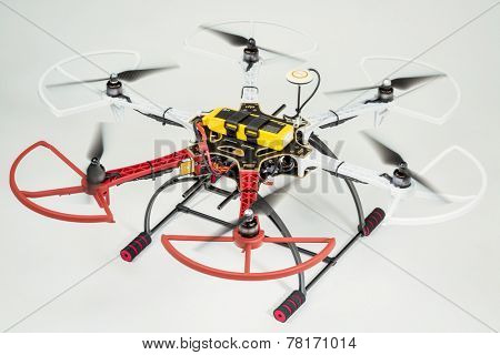 FORT COLLINS, CO, USA, December 13,  2014:  Radio controlled DJI  F550 Flame Wheel  hexacopter drone with spinning rotors on a white background. This drone is assembled from  a kit,