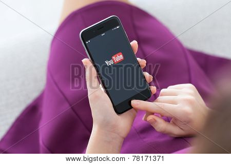 Woman Holding Iphone 6 With Service Youtube On The Screen