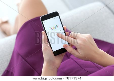 Woman Holding Iphone 6 With Service Google On The Screen