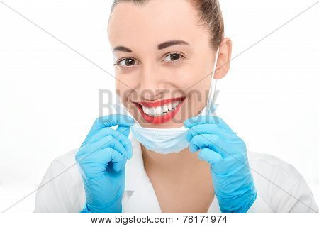 Portrait of young woman doctor on white background