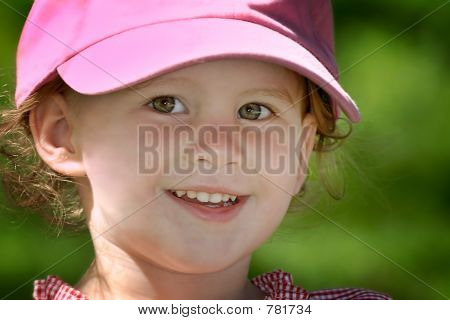 Smiling Young Girl in a Hat
