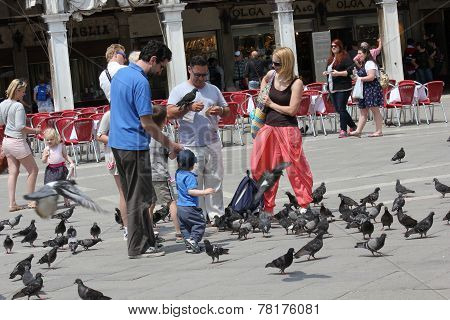 People with pigeons