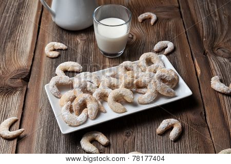 Vanille Cookies And Milk On A Wooden Table