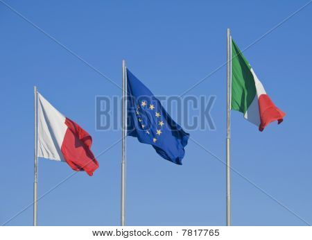Flags on blue sky.