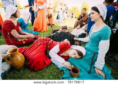 Participants Of Festival Of Medieval Culture Resting In Shadow Tree In Warm Summer Day