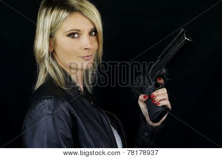 beautiful blonde woman pointing a gun